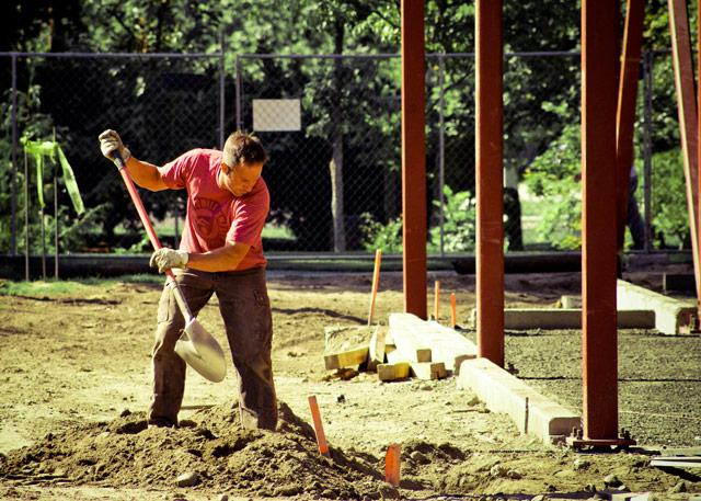 A construction worker breaks ground on the Maxey Hall renovations. The expansion is set to be ready for the fall 2010 semester. Credit: Van Neste
