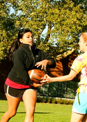Bethany Lovell '10 passes the ball to Melissa Navarro '10 during a drill.