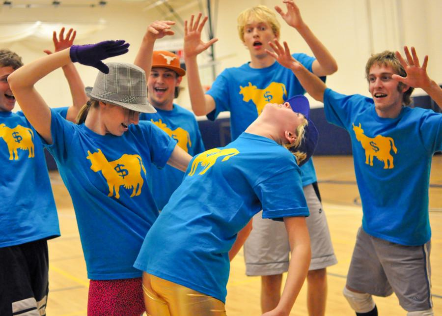 Dance crew Money in the Cow (from left: Alixander Bowman '11, Matt McMillan '12, Thomas Knook '12, Quinn Taylor '11 and Graham Toben '10) prepare for the Cakes for CASA dance-off. Credit: Bullion