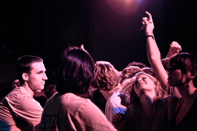 Stephen Stradley, WEB chair, stands between the crowd at the Menomena performance last December. (Photo Credit : Bullion)