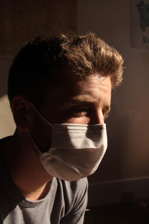 Rex Rolle, Class of 13, models as an ill student with the flu, Fall 2010. Photo Credit: Kendra Klag
