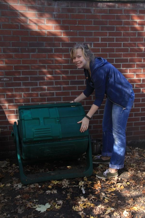 Green Leader Lillian Soshnik-Tanquist '14 shows off and turns the composting bin outside of Lyman.  Photo Credit: Marin Axtell