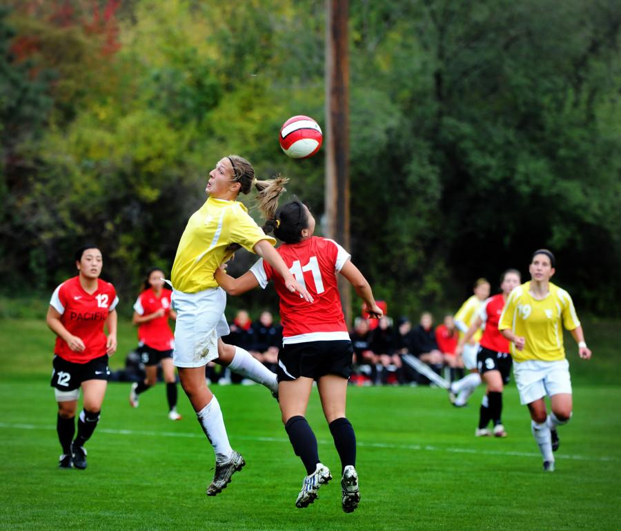 Amy Hasson '12 engages with the competition as she goes up for a header in Whitmans game against Pacific on Oct 23.  Despite outshooting Pacific 23 to 7, Whitman was unable to capitalize on early opportunities. The game ended in a 2-2 tie. Photo Credit: David Jacobson
