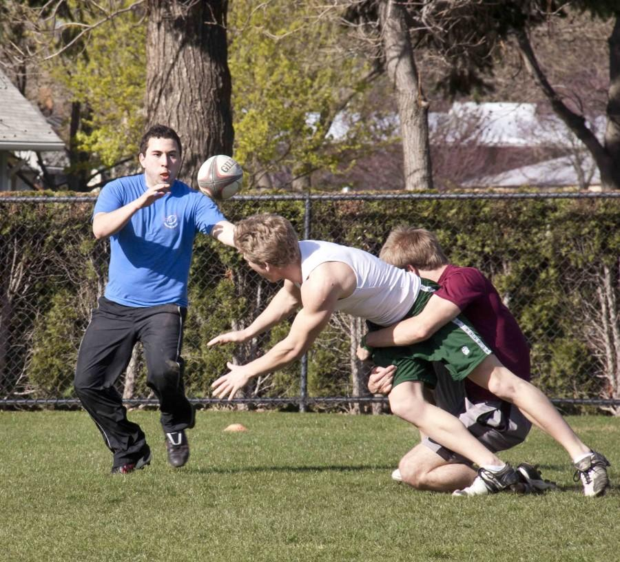 Ruggers run through a play during practice. The Reapers experienced a noticeable drop in numbers this spring, leaving them with a weaker team.  Photo Credit: Marie von Hafften
