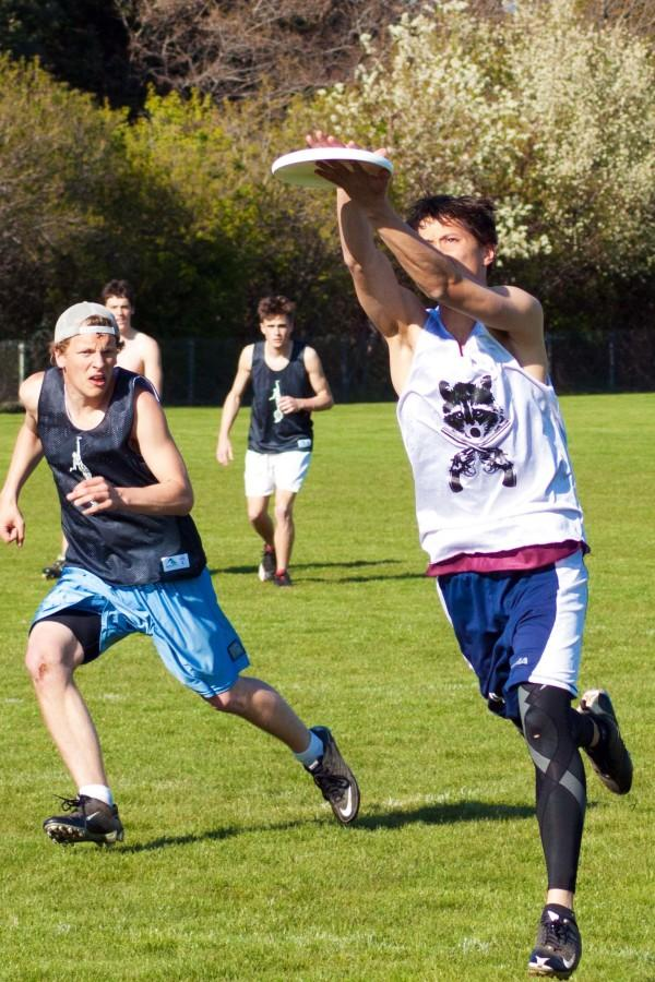 Jeremy Norden '11, marked by Peter Burrows '13, clamshells the frisbee during practice. Photo Credit: Ethan Parrish