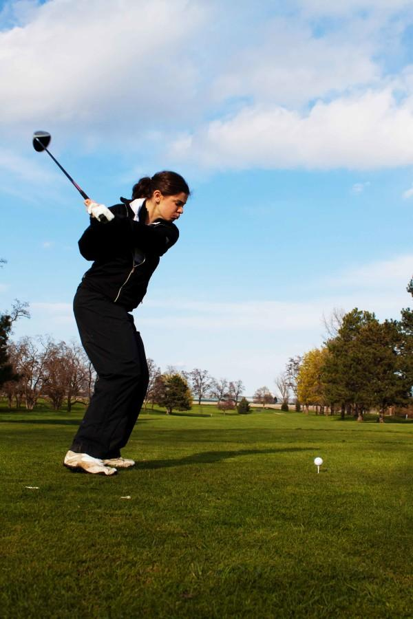 Leading first-year golfer Katie Zijacek practices her drive.  Photo Credit: Ethan Parrish