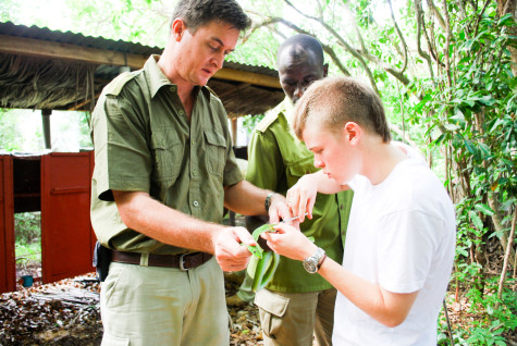 Jordan (left) handling a green mamba held by Royjan Taylor at Bio-Ken research centre at Watamu.  Photo contributed by Steve Spawls.