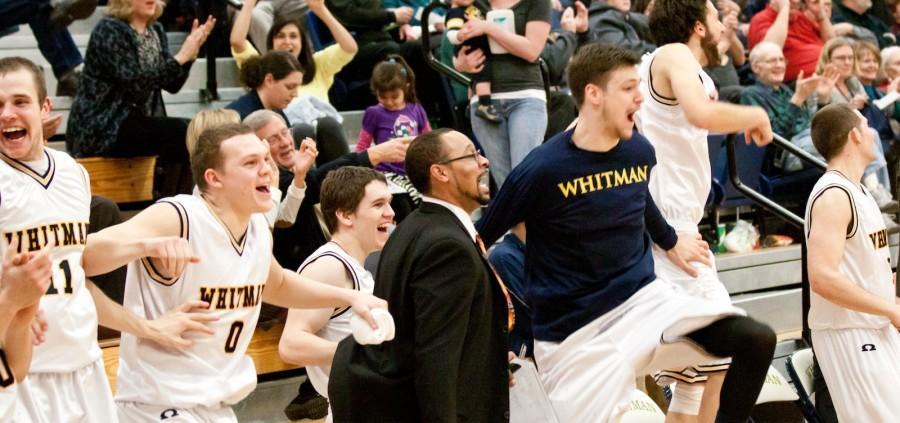 The bench rejoices as Morgan Outzen '16 scores a deuce at Friday's game against Linfield.