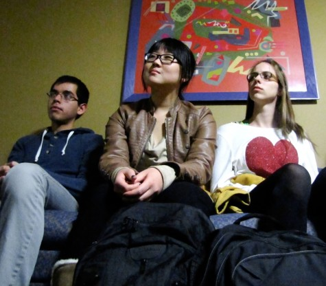 Joel Ponce '16, Ziyi 'Vicky' Su '16, and Ashley Ehlers '13 listen during the afterlife discussion.