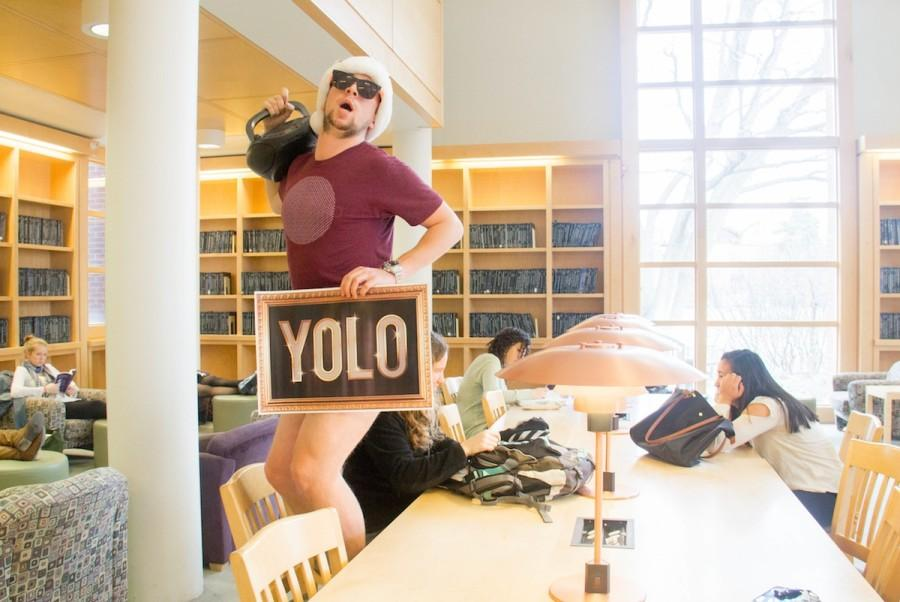 Troy Warwick '16 YOLO's it up in the silent room at Penrose Library. Blaring music, no pants...how much more could he be living?