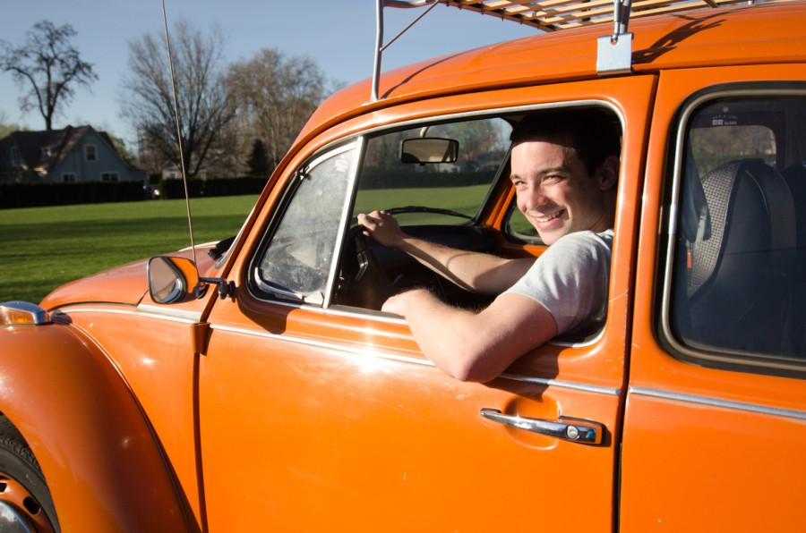 Steven Klutho '13 and his '74-ish Volkswagen Beetle.  Photos by Faith Bernstein.