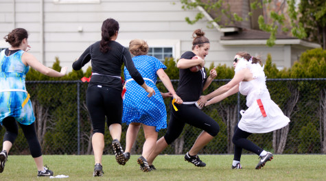 Mary Madden '13 runs down the field at Greekend's football tournament.  Photos by Halley McCormick.