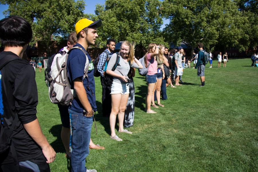 Encounters students gather on Ankeny Field to protest Whitman's recent low ranking of economic diversity. Photo by Halley McCormick.
