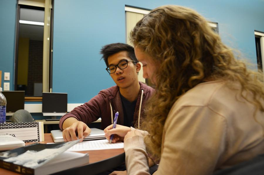 Marisa Ikert assists a student. Photo by Nikki Antenucci.
