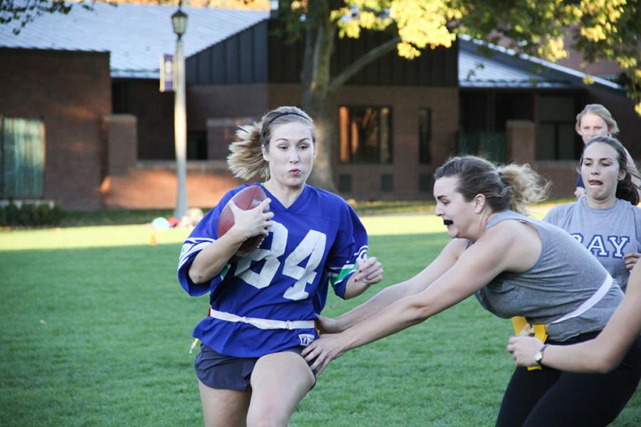 Riley Foreman (2015) runs with the ball.  Photo by Hannah Bashevkin.