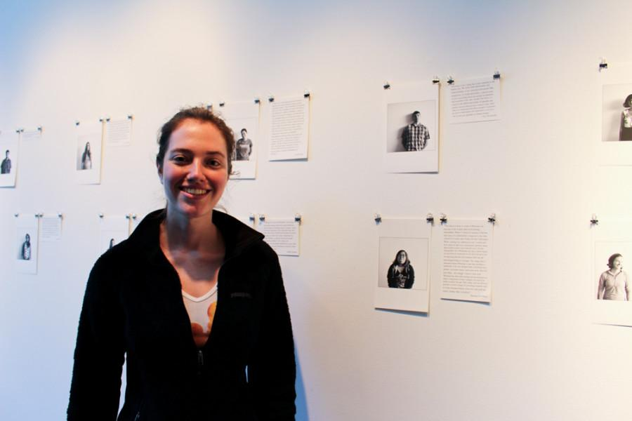 Maia Watkins 17 displays her photographs in Fouts Center for the Visual Arts. Photo by Emily Volpert.