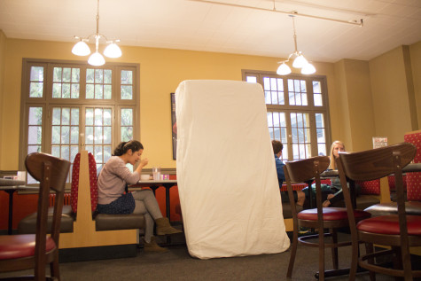 Sophomore Annie Want with a mattress in Prentiss Dining Hall. Photo by Marra Clay.