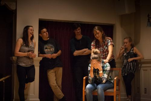 From left to right, Kinsey White '15, Sam Adler '15, Reid Watson '17, Hannah Davenport '16 (sitting), Jo Canino '17, and Roxanne Stathos '17 amuse their audience. Photo by Annabelle Marcovici.