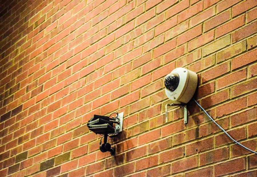 Security cameras are visible around campus, including this one in Reid's Cafe 66. Photo by Anna Dawson.