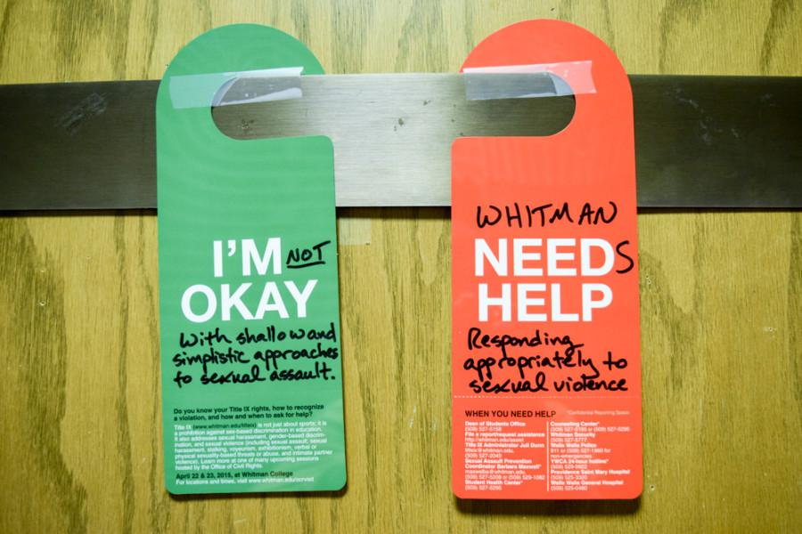 Professor Melissa Wilcox amended the door hangers produced in conjunction with the visit from representatives from the Office of Civil Rights. Photo by Anna Dawson.
