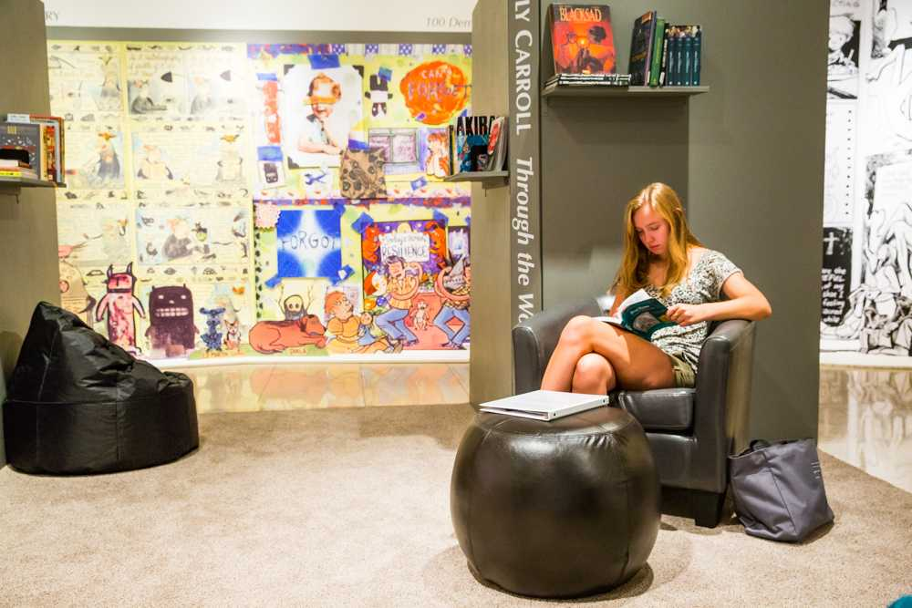 Louise Karneus ('16) is pictured here reading in the central lounge of the exhibit.