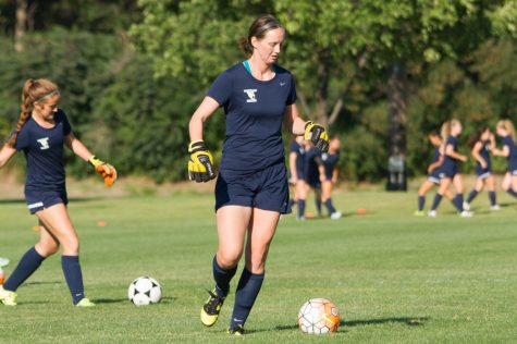 Senior Haley Case practices drills with her fellow goal keepers.