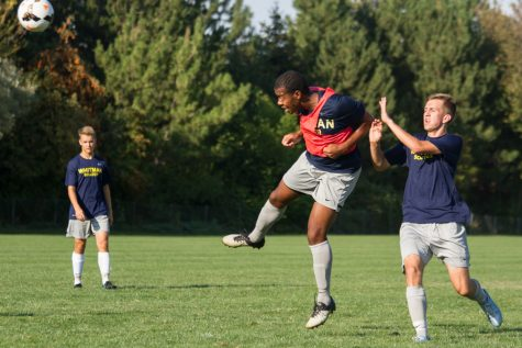 Senior Trayvon Foy heads the ball during a defensive drill.