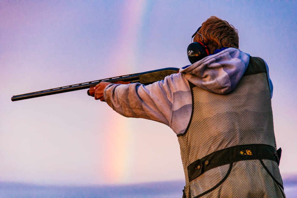 A Walla Walla resident trap shoots against a rainbow backdrop.  Photo by Tywen Kelly.