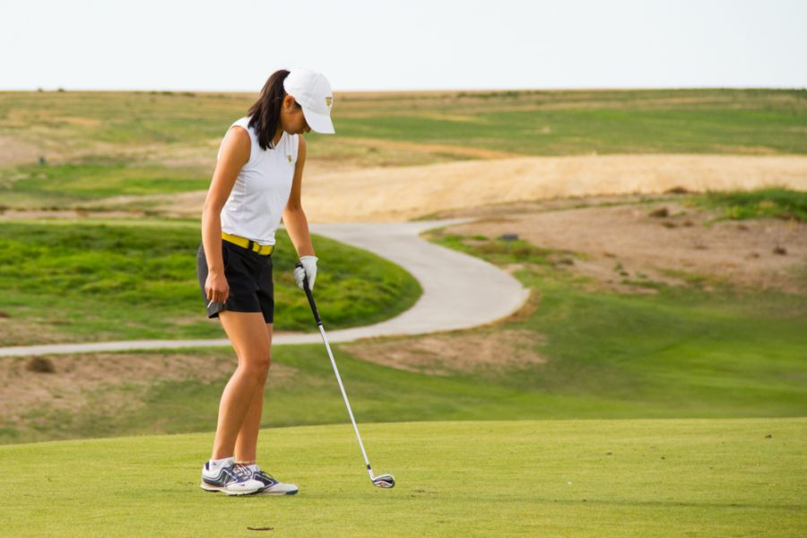 Phoebe Nguyen, senior, captain of the women's golf team. Photo archived. Photo by Natalie Mutter