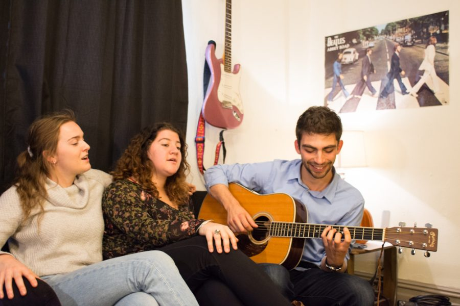 Eve Goldman, Chloe Serkissian and Jake Barokas jamming on the tiny futon. Photo by Carson Jones