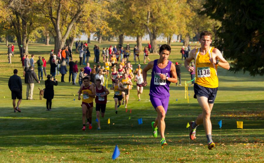 Senior Will Mullins inches ahead of a competitor from Linfield. Photo by Natalie Mutter