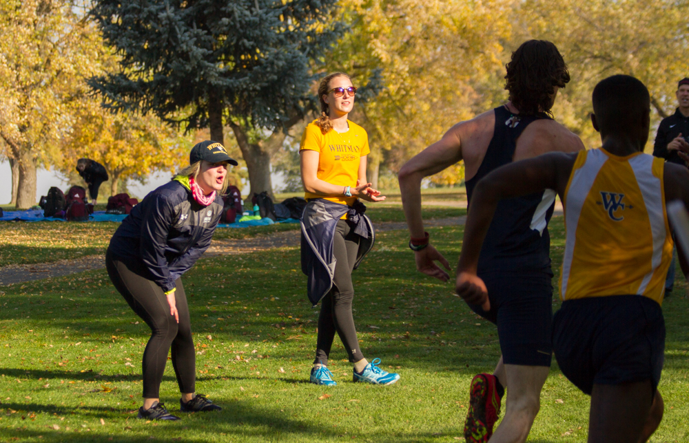 Members+of+the+women%27s+cross+country+team+cheering+on+their+fellow+runners.+Photo+by+Natalie+Mutter