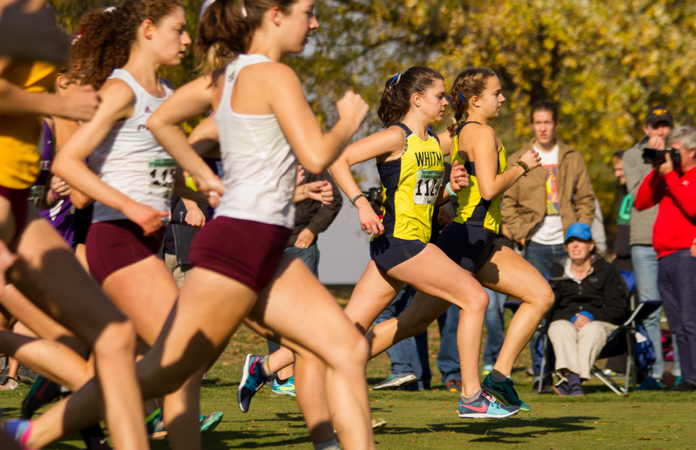 Sophomore+Whitney+Rich+and+junior+Lucy+O%27Sullivan+leading+the+pack+near+the+start+of+the+race.+Photo+by+Natalie+Mutter