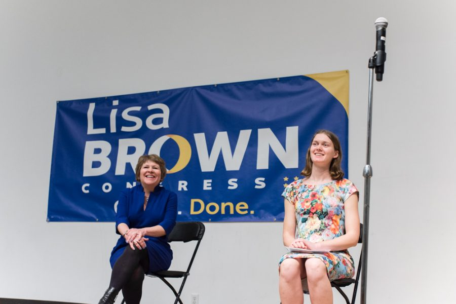Lisa Brown (left) and FACE representative junior Georgia Lyon (right) at Monday's town hall-style event.