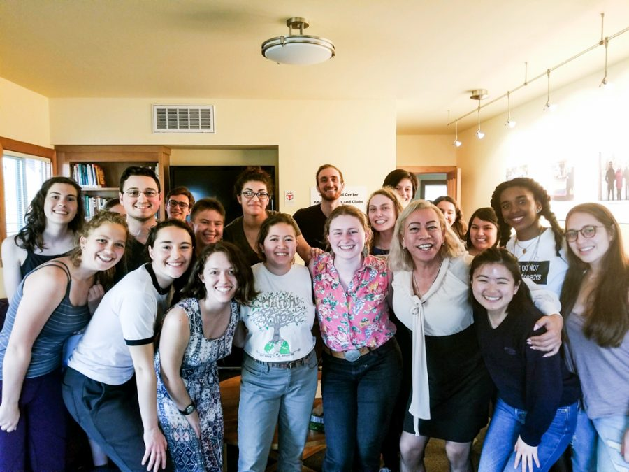 Salcedo, 5 from right, poses here with students at the Glover Alston Center. Salcedo has received numerous awards for her work, notably the West Coast Liberty Award, James Earl Hardy Legends Award, and the Women in Leadership Award, among with others.