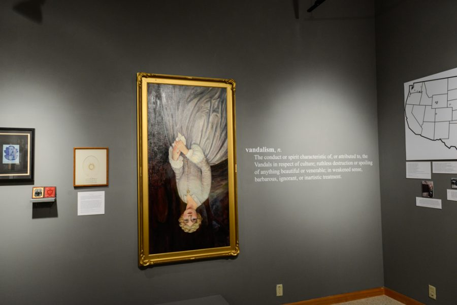 A Proper Monument a joint faculty and student curated exhibit in Maxey Museum, adds to the discourse surrounding the defacement of the Whitmans monuments. It featured the restored Narcissa Whitman portrait, here hung upside down with an accompanying definition of vandalism.