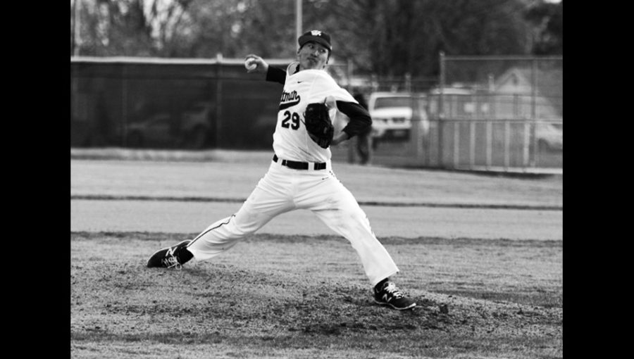 Eric Ma '20 pitches over the summer for Conejo Oaks, a now championship team. Photo courtesy of Whitman Athletics.