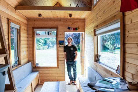 Sophomore Brayden Preskenis stands with the tiny home he has been building since he was 13.