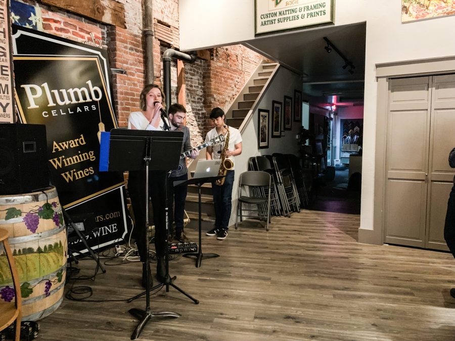 From left to right. Anna Ballew '18, Jake Barokas '18, and Daniel Leong '21 performing at Plumb Cellars.