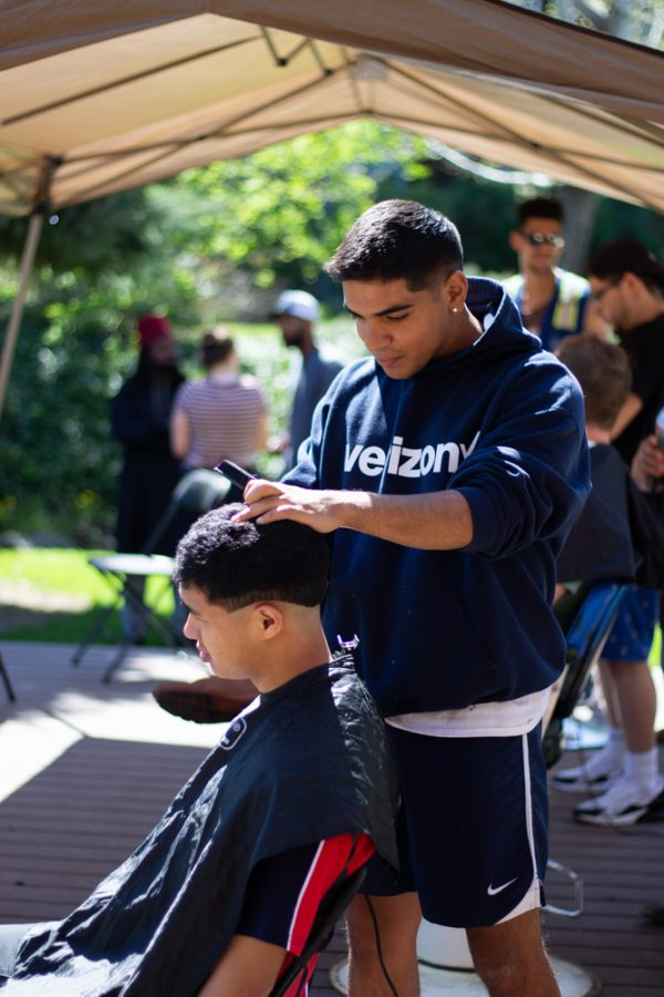 Members of the Whitman Men of Color Association host a barbershop on the Reid sidelawn, donating all proceeds to the Walla Walla Music Organization.