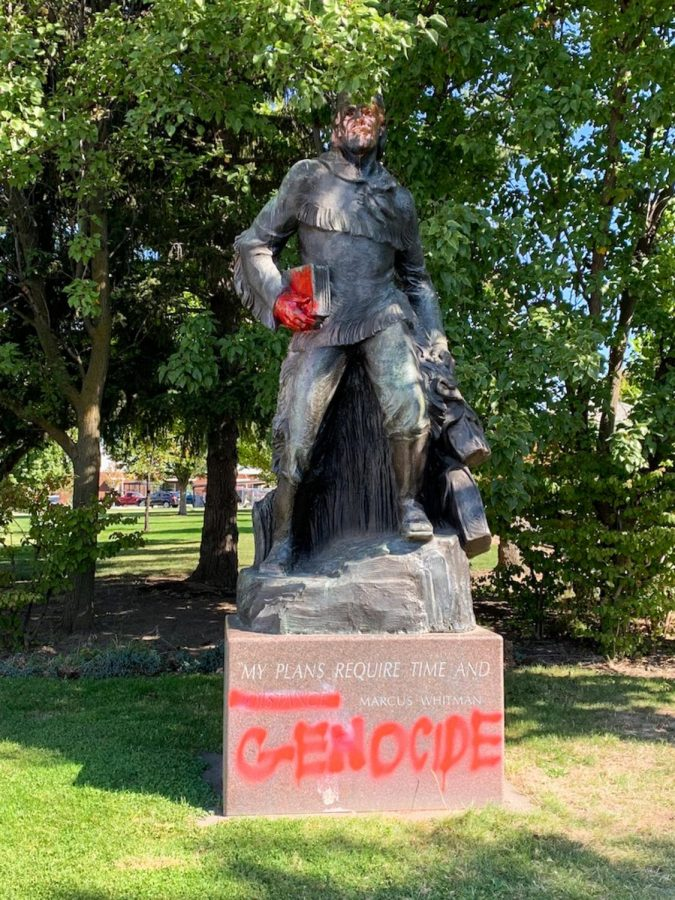 The+Marcus+Whitman+statue+on+the+edge+of+campus+was+spray-painted+red+multiple+times+in+the+weeks+leading+up+to+Columbus+Day+along+with+other+messages+scattered+across+Whitman+campus.+Photo+contributed+by+Kaitlyn+Patia