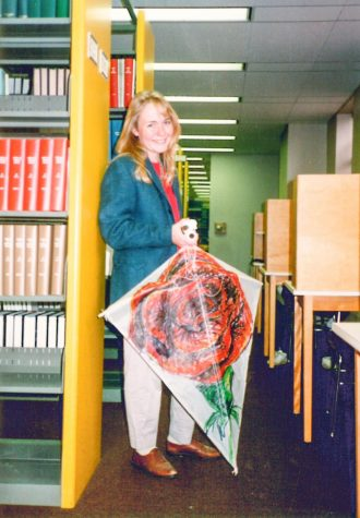 Associate Professor of Foreign Languages and Literatures Sarah Hurlburt, as a student, searches for a friend to fly her homemade kite in the library. Photo contributed by Sarah Hurlburt