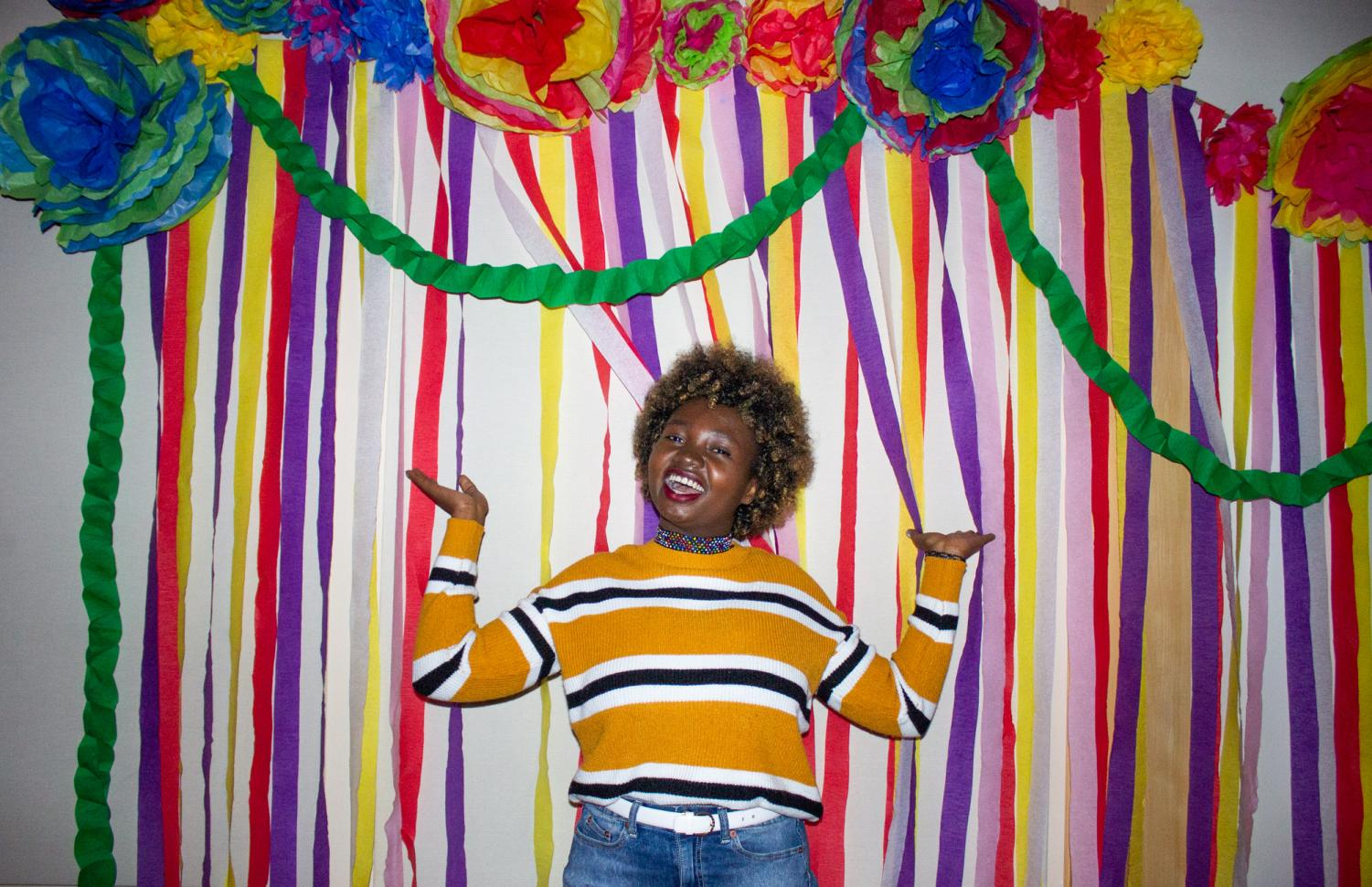Sophomore Sylvia Adome poses at the event's photo booth