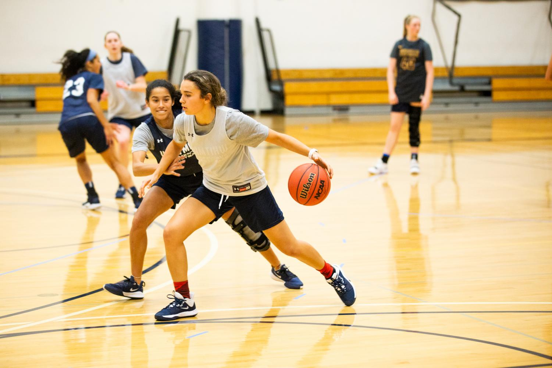 First-year Macy Hampton dribbles the ball.