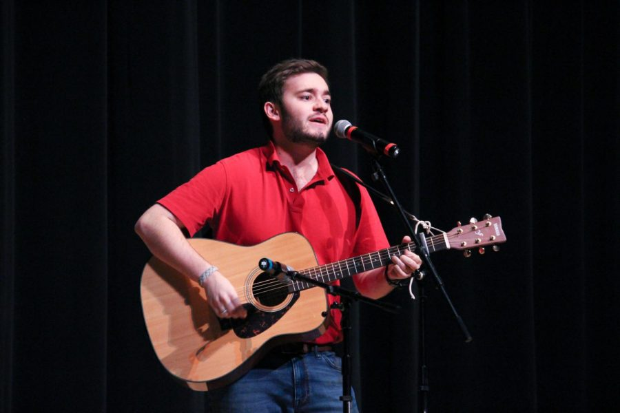 Senior contestant Stuart Ashford sings for the audience at Mx. Whitman.