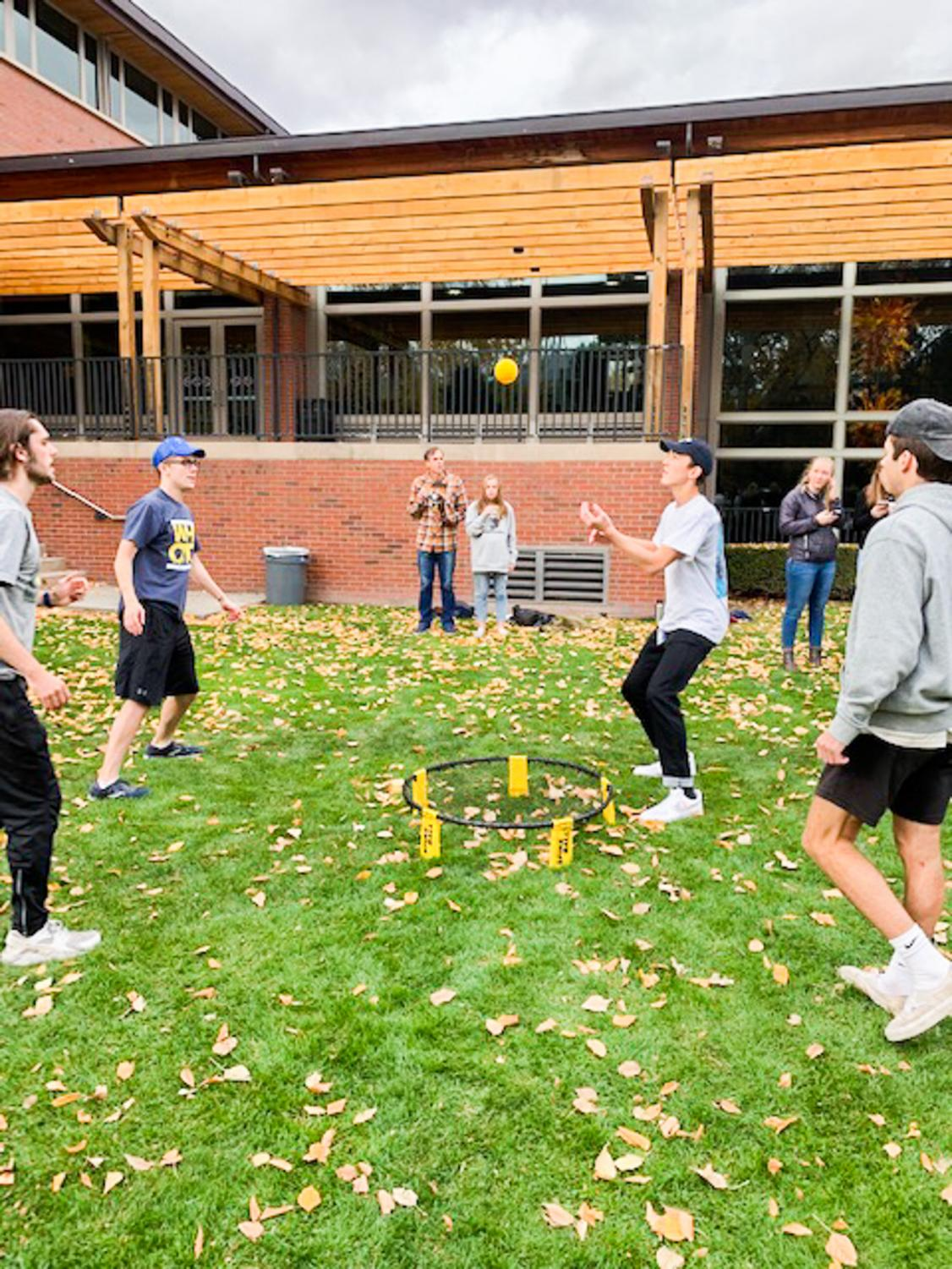 Students and parents enjoy a friendly, competitive game of spikeball during Family Weekend. Photos contributed by Peter Fitch