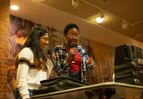 Sophomores Maya Mohan and Hannah Paul sing at the karaoke event