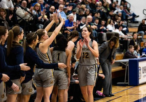 Senior Lily Gustafson high-fives teammates. Photos by James Baker