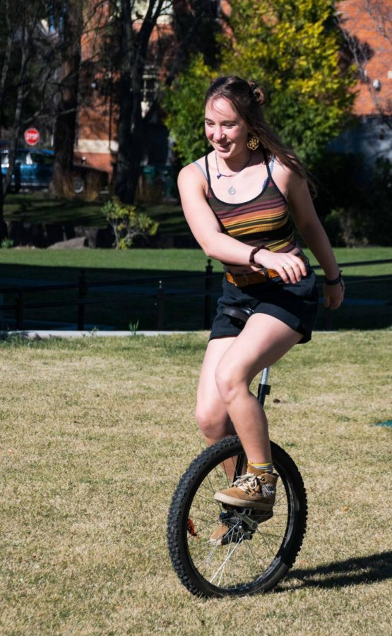 Kaia Schweig getting around on her unicycle. Photos by Michael Lans
