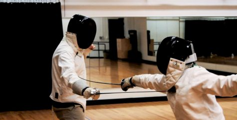 Two students in fencing club duel in Italian style, the more artistic of the two fencing styles. Photo contributed by West Skrobiak-Bales